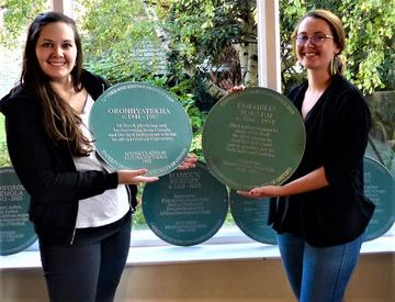 Paula Larsson and Olivia Durand unveil the plaques